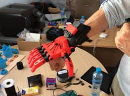 Alexander Betts trying a 3D-printed prosthetic hand, Za'atari Camp, Jordan